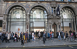 © Licensed to London News Pictures. 24/09/2015. London, UK. A poster of an iPhone 6S is seen in the shop window of the Apple Store in Regent Street. The iPhone 6s goes on sale at 8 am in the UK tomorrow. Photo credit: Peter Macdiarmid/LNP