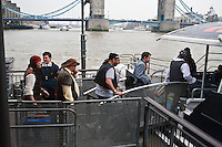 Modern day pirates board a river boat on the Thames, London, England.
