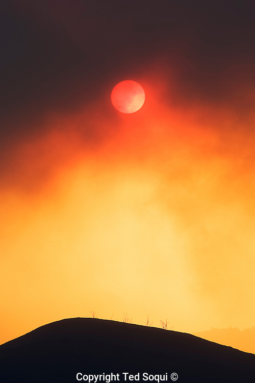"""The sun obscured by smoke form the """"Magic Fire"""" in Valencia, California.."""