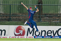 © Licensed to London News Pictures. 01/10/2012. Englishmen Steve Finn takes a one handed catch mid air but went over the boundary line during the T20 Cricket World super 8's match between England Vs Sri Lanka at the Pallekele International Stadium Cricket Stadium, Pallekele. Photo credit : Asanka Brendon Ratnayake/LNP
