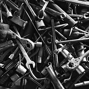 Tools sit on the floor of a mechanic's shop in Tha Ket, Laos.