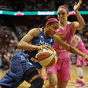 Maya Moore, Minnesota Lynx, drives to the basket defended by Kelly Faris, Connecticut Sun, during the Connecticut Sun Vs Minnesota Lynx, WNBA regular season game at Mohegan Sun Arena, Uncasville, Connecticut, USA. 27th July 2014. Photo Tim Clayton