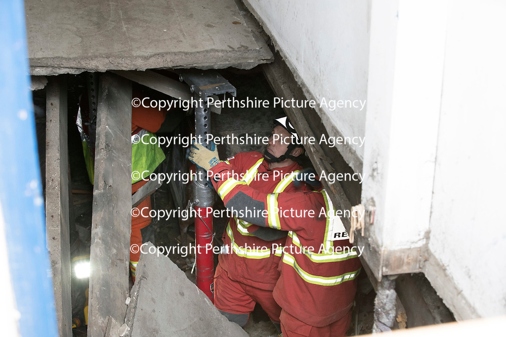Firefighters attempting to shore up a floor in Atholl Street, Perth after a woman was injured when the floor collapsed earlier today..29.03.17 A 25 year old woman is currently being treated in Perth Royal Infirmary for minor injuries. Residents from the bloack of flats have been evacuated to allow fror a structural assessment to take place.<br />