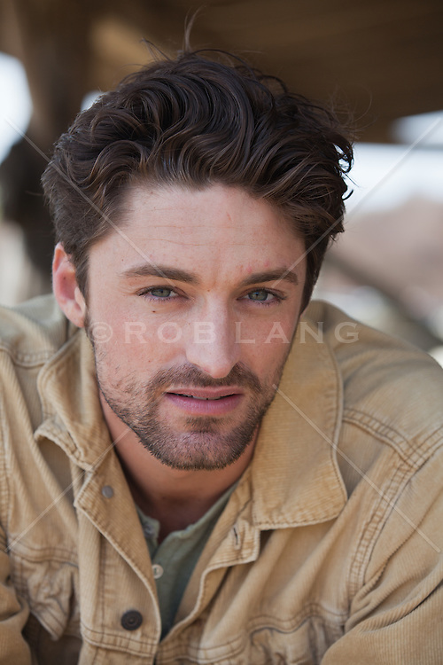 portrait of a good looking  man with a scruffy face