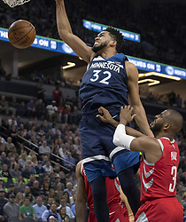April 23, 2018 - Minneapolis, MN, USA - Minnesota Timberwolves' Karl-Anthony Towns (32) dunks the ball in the second quarter as the Timberwolves played the Houston Rockets in Game 4 of their series Monday, April 23, 2018 at the Target Center in Minneapolis, Minn. (Credit Image: © Carlos Gonzalez/TNS via ZUMA Wire)