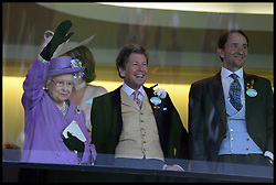 HM The Queen with her racing manager John Warren waves to the crowd after winning the Gold Cup with her horse Estimate in the Royal Box at Royal Ascot 2013 Ascot, United Kingdom,<br /> Thursday, 20th June 2013<br /> Picture by Andrew Parsons / i-Images
