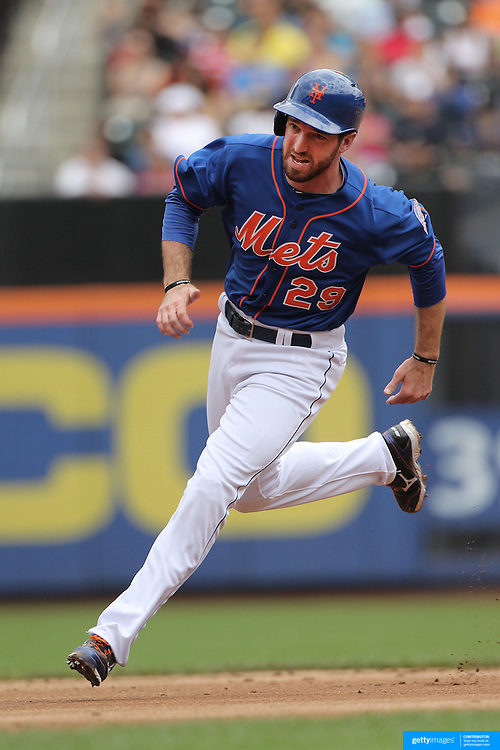 Ike Davis, New York Mets, scoring a run during the New York Mets V Miami Marlins, Major League Baseball game which went for 20 innings and lasted 6 hours and 25 minutes. The Marlins won the match 2-1. Citi Field, Queens, New York. 8th June 2013. Photo Tim Clayton