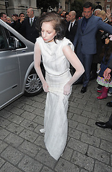 Lady Gaga leaving her London hotel dressed in all white takes very slow walk to her waiting car with tears in her eyes. UK. 01/10/2013<br />