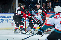 KELOWNA, CANADA - FEBRUARY 20:  Rhett Rhinehart #3 and Brogan O'Brien #15 of the Prince George Cougars checks Jack Cowell #8 of the Kelowna Rockets in front of the net during first period on February 20, 2018 at Prospera Place in Kelowna, British Columbia, Canada.  (Photo by Marissa Baecker/Shoot the Breeze)  *** Local Caption ***