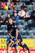 6th October 2018, Dens Park, Dundee, Scotland; Ladbrokes Premiership football, Dundee versus Kilmarnock; Andy Boyle of Dundee dominates in the air over Greg Stewart of Kilmarnock