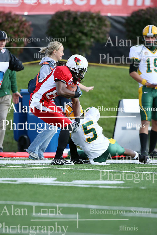 25 October 2008: John Richardson gets stops Kelvin Chandler by grabbing Chandlers left leg in a game which the North Dakota Bison defeated the Illinois State Redbirds at Hancock Stadium on campus of Illinois State University in Normal Illinois