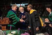 "President Nellis congratulates  Venkatraman ""Venki"" Ramakrishnan on receiving an honorary degree at gradute commencement. Photo by Ben Siegel"