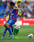 VALENCIA, SPAIN - JUNE 01: (L) Pedro Rios of Levante UD competes for the ball with (R) Ruben Perez of Real Betis Balompie during the Liga BBVA between Levante UD and Real Betis Balompie at the Ciutat de Valencia stadium on June 01, 2013 in Valencia, Spain. (Photo by Aitor Alcalde Colomer).