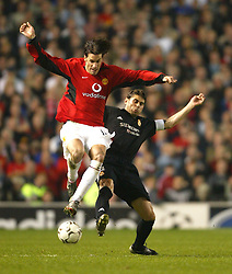 MANCHESTER, ENGLAND - Wednesday, April 23, 2003: Real Madrid's Fernando Hierro and Manchester United's Ruud Van Nistelrooy  during the UEFA Champions League Quarter Final 2nd Leg match at Old Trafford. (Pic by David Rawcliffe/Propaganda)