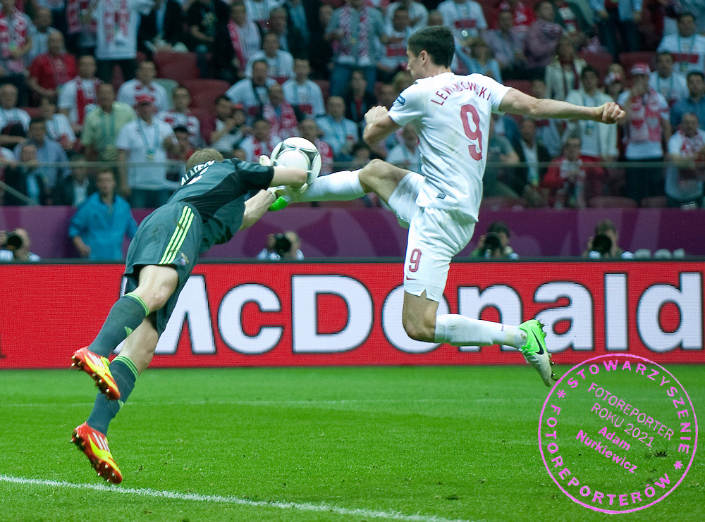 (R) Poland's Robert Lewandowski (nr09) fights for the ball with (L) Russia's goalkeeper Vyacheslav Malafeev (nr16) during their the UEFA EURO 2012 Group A football match between Poland and Russia at National Stadium in Warsaw on June 12, 2012...Poland, Warsaw, June 12, 2012..Picture also available in RAW (NEF) or TIFF format on special request...For editorial use only. Any commercial or promotional use requires permission...Photo by © Adam Nurkiewicz / Mediasport