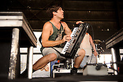 Family Force 5 performing on Warped Tour at Verizon Wireless Amphitheater in St. Louis, Missouri on August 3, 2011. © Todd Owyoung.