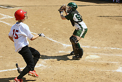 05 April 2008: Kelly Nelson gets a throw for a play at the plate well before Kelsey Epping approaches. The Carthage College Lady Reds lost the first game of this double header to the Titans of Illinois Wesleyan 4-1 at Illinois Wesleyan in Bloomington, IL