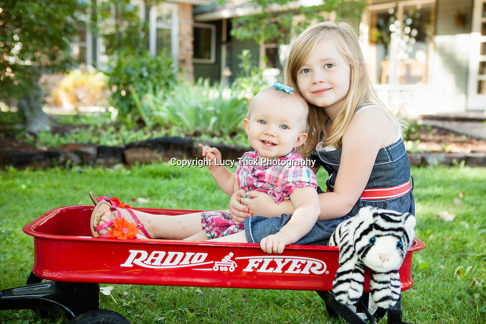 Young children in wagon, sibling photos