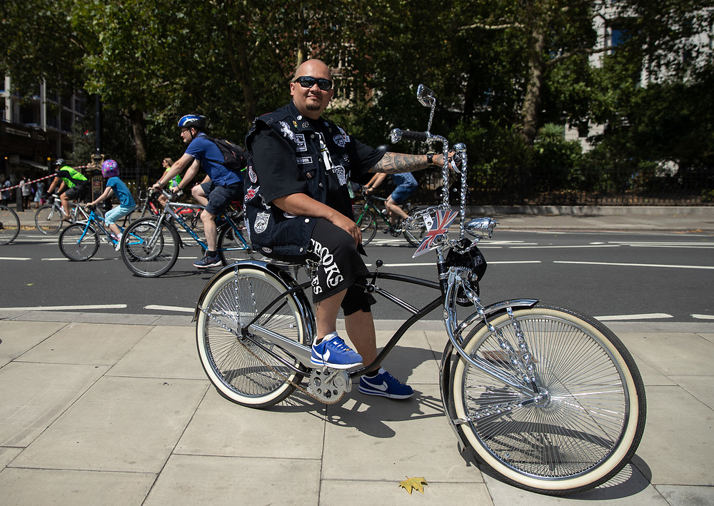 Rider poses with his custom bike on The Victoria Embankment. The Prudential RideLondon FreeCycle. Saturday 28th July 2018<br /> <br /> Photo: Ian Walton for Prudential RideLondon<br /> <br /> Prudential RideLondon is the world's greatest festival of cycling, involving 100,000+ cyclists - from Olympic champions to a free family fun ride - riding in events over closed roads in London and Surrey over the weekend of 28th and 29th July 2018<br /> <br /> See www.PrudentialRideLondon.co.uk for more.<br /> <br /> For further information: media@londonmarathonevents.co.uk