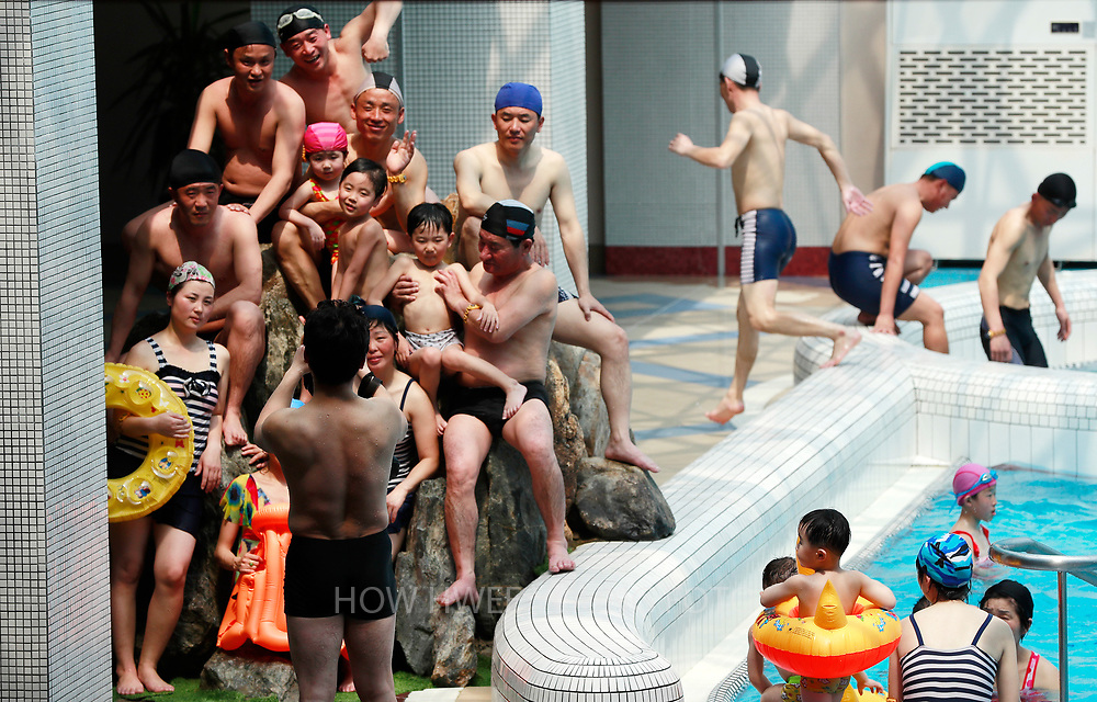 North Korean people take a photos in the Munsu Water Park during a national holiday as part of celebrations of the 'Day of the Sun', commemorating the 105th birth anniversary of late supreme leader Kim Il-sung in Pyongyang, North Korea, 16 April 2017. A North Korean missile exploded within seconds of its launch on the east coast on 16 April, South Korean and US officials say as tensions rise in the region over nuclear issues.