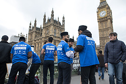 "© Licensed to London News Pictures . 29/03/2017 . London , UK . Men wearing ""I AM A MUSLIM ask me anything "" t-shirts on Westminster Bridge outside Parliament in Westminster today (29th March 2017) . Photo credit : Joel Goodman/LNP"