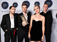 Wolf Alice arrival board with award