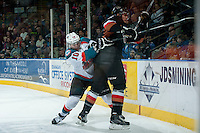 KELOWNA, CANADA - FEBRUARY 28: Nick Merkley #10 of Kelowna Rockets stick checks Keegan Kanzig #5 of Calgary Hitmen on February 28, 2015 at Prospera Place in Kelowna, British Columbia, Canada.  (Photo by Marissa Baecker/Shoot the Breeze)  *** Local Caption *** Nick Merkley; Keegan Kanzig;