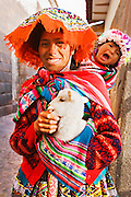 A WOMAN DRESSED IN THE TRADITIONAL WAY IN ONE STREET OF CUSCO, PERU.