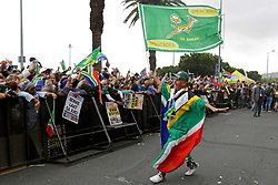 Monday 11th November 2019.<br /> City Hall, Grand Parade,<br /> And City Centre, Cape Town,<br /> Western Cape,<br /> South Africa.<br /> <br /> SPRINGBOKS CELEBRATE WINNING THE RUGBY WORLD CUP CHAMPIONSHIP IN 2019 WITH A COUNTRYWIDE VICTORY TOUR!<br /> <br /> SPRINGBOKS RUGBY WORLD CUP VICTORY TOUR CAPE TOWN!<br /> <br /> An festive female fan wearing a South African flag outfit dances with a Springbok flag as she and other excited fans on Cape Town's Grand Parade celebrate the Springboks.<br /> <br /> The reigning Rugby World Cup Champions namely the South African Springbok Rugby Team, celebrates winning the Webb Ellis Cup during the International Rugby Football Board Rugby World Cup Championship held in Japan in 2019 with their Victory Tour that culminated in the final city tour taking place in Cape Town. Thousands of South African fans filled the streets of the city all trying their best to show their support for their beloved Springboks and to celebrate them winning the Rugby World Cup for the third time. South Africa previously won the Rugby World Cup in 1995, 2007 and now again in 2019. South African Springbok Captan Siya Kolisi took the opportunity to speak to the gathered crowd about how something like this brings unity and that we should live together as a nation that practices what is known as ubuntu. Ubuntu is a quality that includes the essential human virtues of compassion and humanity. This image taken in Cape Town on Monday 11th November 2019.<br /> <br /> This image is the property of Seven Bang Media Group (Pty) Ltd, hereinafter referred to as SBM.<br /> <br /> Picture By: SBM / Mark Wessels. (11/11/2019).<br /> +27 (0)61 547 2729<br /> mark@sevenbang.com<br /> www.sevnbang.com<br /> <br /> Copyright © SBM. All Rights Reserved.