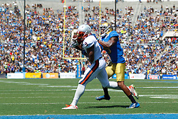 PASADENA, CA - SEPTEMBER 05:  Wide receiver Canaan Severin #9 of the Virginia Cavaliers catches a pass short of the goal line in front of defensive back Marcus Rios #9 of the UCLA Bruins during the second quarter at the Rose Bowl on September 5, 2015 in Pasadena, California. The UCLA Bruins defeated the Virginia Cavaliers 34-16. (Photo by Jason O. Watson/Getty Images) *** Local Caption *** Canaan Severin; Marcus Rios