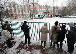 61009943<br /> People at a fence surrounding a school in northeast Moscow, where a high-school student took fellow pupils hostage and shot a teacher and a police officer dead. The teenager has been detained, Moscow, Russia, Monday, 3rd February 2014. Picture by  imago / i-Images<br /> UK ONLY