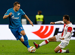 October 4, 2018 - Saint Petersburg, Russia - Artem Dzyuba (L) of FC Zenit Saint Petersburg and Josef Husbauer of SK Slavia Prague vie for the ball during the Group C match of the UEFA Europa League between FC Zenit Saint Petersburg and SK Sparta Prague at Saint Petersburg Stadium on October 4, 2018 in Saint Petersburg, Russia. (Credit Image: © Mike Kireev/NurPhoto/ZUMA Press)