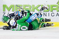 Brock McBride (HDD Tilia Olimpija, #10) and Martin Grabher Meier (EHC Liwest Linz, #91) during ice-hockey match between HDD Tilia Olimpija and EHC Liwest Black Wings Linz at fourth match in Semifinal  of EBEL league, on March 13, 2012 at Hala Tivoli, Ljubljana, Slovenia. (Photo By Matic Klansek Velej / Sportida)
