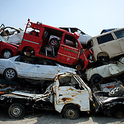 May 27, 2013 - Ishinomaki, Japan: Hundreds of cars, destroyed by the 2011 tsunami that devastated the east coast of Japan, are seen piled in a recycling center set up to manage waste created by the disaster in the outskirts of Ishinomaki. (Paulo Nunes dos Santos)
