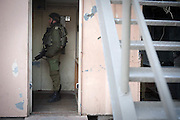 An Israeli soldier stands at a checkpoint in Hebron, Palestinian.Territories. Image © Angelos Giotopoulos/Falcon Photo Agency
