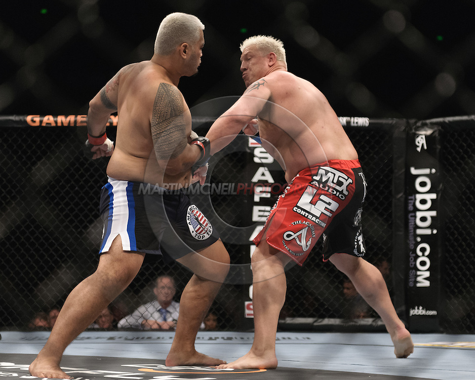 "SYDNEY, AUSTRALIA, FEBRUARY 27, 2011: Mark Hunt (left) and Chris Tuchscherer trade blows during ""UFC 127: Penn vs. Fitch"" inside Acer Arena in Sydney, Australia on February 27, 2011."