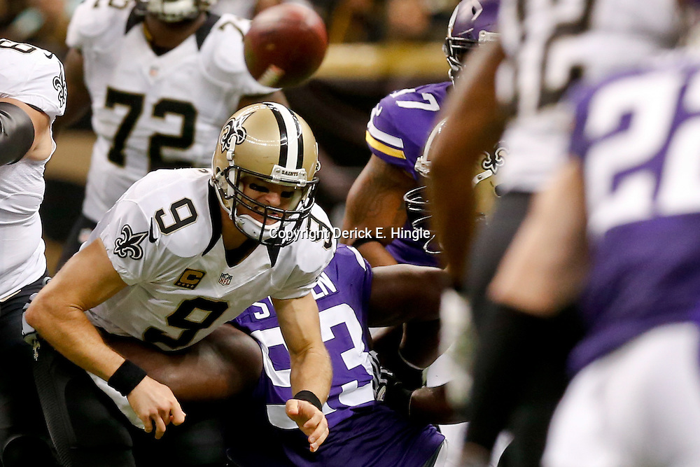 Sep 21, 2014; New Orleans, LA, USA; Minnesota Vikings defensive tackle Shamar Stephen (93) hits New Orleans Saints quarterback Drew Brees (9) as he throws during the second half of a game at Mercedes-Benz Superdome. The Saints defeated the Vikings 20-9. Mandatory Credit: Derick E. Hingle-USA TODAY Sports