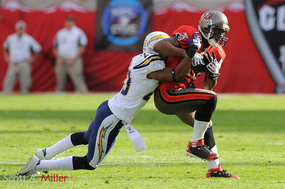 Dec. 21, 2008; Tampa, FL, USA; Tampa Bay Buccaneers wide receiver Ike Hilliard (19) is tackled by San Diego Chargers cornerback Antoine Cason (20) during the second half of the Chargers 41-24 win at Raymond James Stadium. ©2008 Scott A. Miller