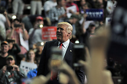 Republican presidential candidate Donald Trump greets voters as he leaves the Giant Center in Hershey, in Central Pennsylvania, four days before the U.S. General Elections.
