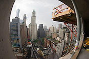 Fish-eye distortion of New York City skyline, seen from city construction site.