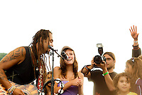 Michael Franti shares stage with children and other attendees at close of 12th Annual Power to the Peaceful Festival in Golden Gate Park, in San Francisco, CA.  Copyright 2010 Reid McNally.
