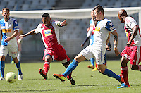 CAPE TOWN, South Africa - Saturday 26 January 2013, Granwald Scott © of Ajax Cape Town challenges Steven Zuber of Grasshopper Club Zurich during the soccer/football match Grasshopper Club Zurich (Switzerland) and Ajax Cape Town at the Cape Town stadium..Photo by Roger Sedres/ImageSA