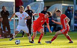 BANGOR, WALES - Monday, October 15, 2018: Wales' Neco Williams (C) and Luke Jephcott (R) tackle Poland's Marcin Grabowski (L) during the UEFA Under-19 International Friendly match between Wales and Poland at the VSM Bangor Stadium. (Pic by Paul Greenwood/Propaganda)