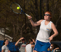 Gilford's Emily Curtis goes for a long forehand return during her singles match with White Mountain on Wednesday afternoon.  (Karen Bobotas/for the Laconia Daily Sun)