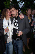 Olivier Garbay and Sara Lucas. The Serpentine Summer party co-hosted by Jimmy Choo. The Serpentine Gallery. 30 June 2005. ONE TIME USE ONLY - DO NOT ARCHIVE  © Copyright Photograph by Dafydd Jones 66 Stockwell Park Rd. London SW9 0DA Tel 020 7733 0108 www.dafjones.com