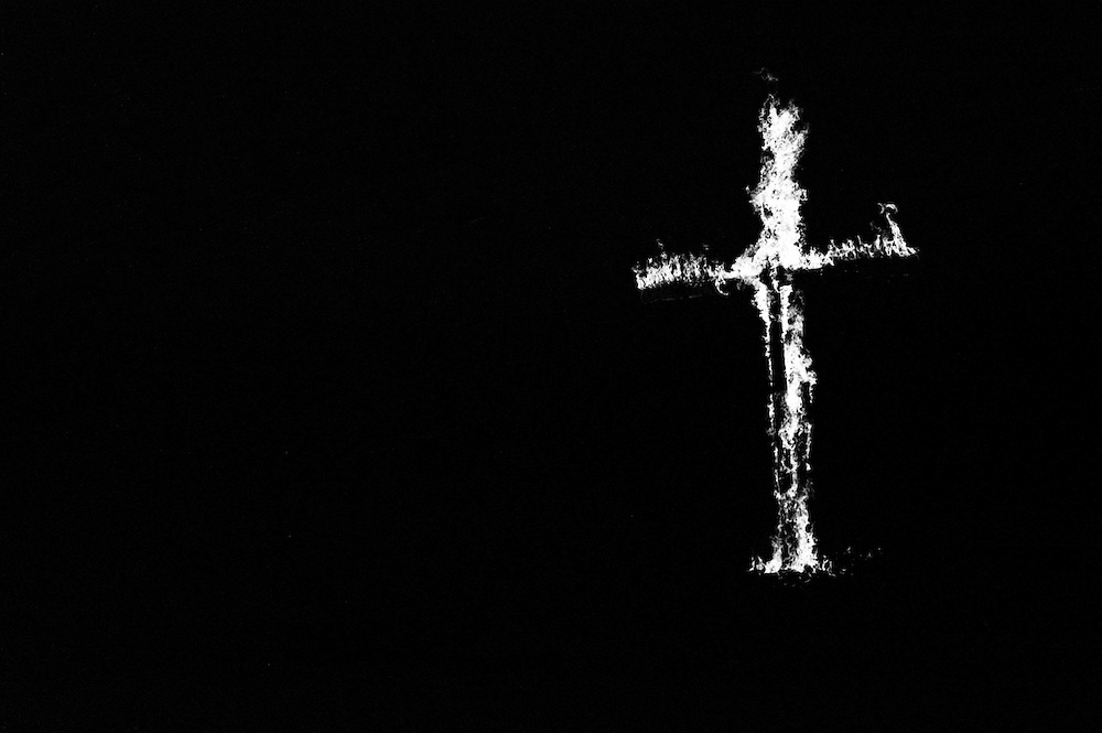 A giant cross blazes on a farm in Osceola, Indiana. (Photo by William B. Plowman)