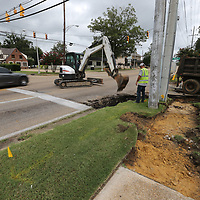 Motorists make their way past Tupelo Public Works employees as they remove a section of curb to be replaced at the intersection of Madison and West Main Streets in Tupelo on Wednesday.