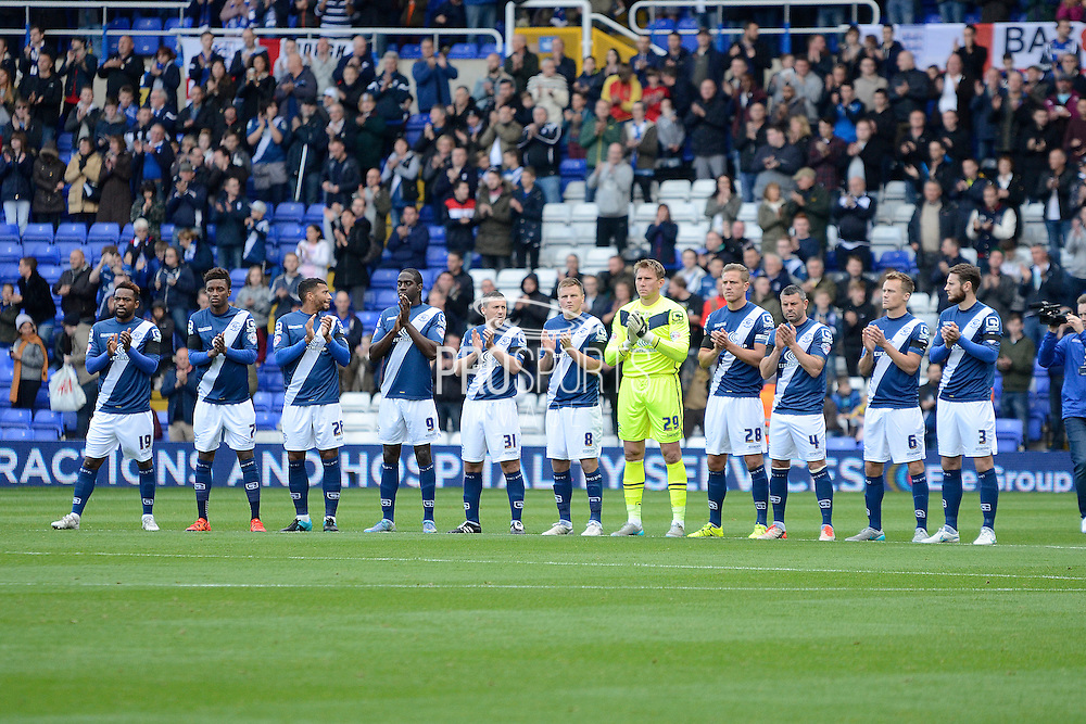 Birmingham players pay respect to Howard Kendall during the Sky Bet Championship match between Birmingham City and Queens Park Rangers at St Andrews, Birmingham, England on 17 October 2015. Photo by Alan Franklin.