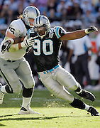 CHARLOTTE, NC - NOVEMBER 7:  Defensive end Julius Peppers #90 of the Carolina Panthers gets blocked by rookie tackle Robert Gallery #76 of the Oakland Raiders at Bank of America Stadium on November 7, 2004 in Charlotte, North Carolina. The Raiders defeated the Panthers 27-24. ©Paul Anthony Spinelli  *** Local Caption *** Julius Peppers;Robert Gallery