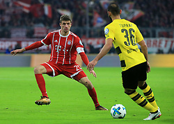 MUNICH, Dec. 21, 2017  Bayern Munich's Thomas Mueller (L) pressures on Dortmund's Oemer Toprak during a German Cup 3rd round match between Bayern Munich and Borussia Dortmund, in Munich, Germany, on Dec. 20, 2017. Bayern Munich won 2-1 and advanced into quaterfinals. (Credit Image: © Philippe Ruiz/Xinhua via ZUMA Wire)